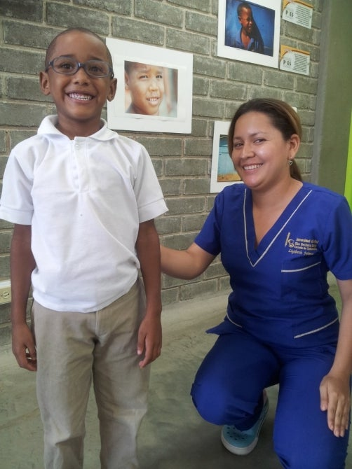 Colombian elementary school child with his new eye glasses