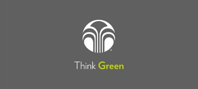 "Nu Skin logo with ""Think Green"" text on dark grey background"