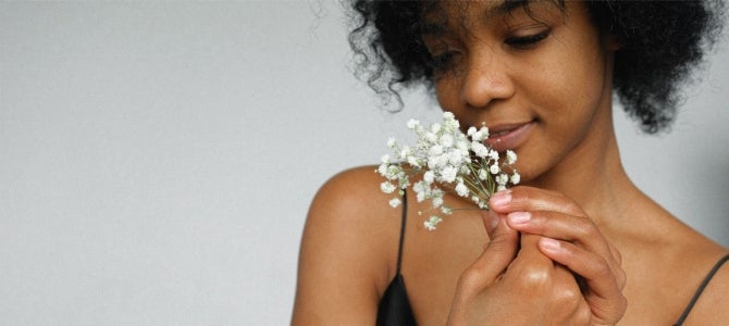 women smelling baby's breath flowers