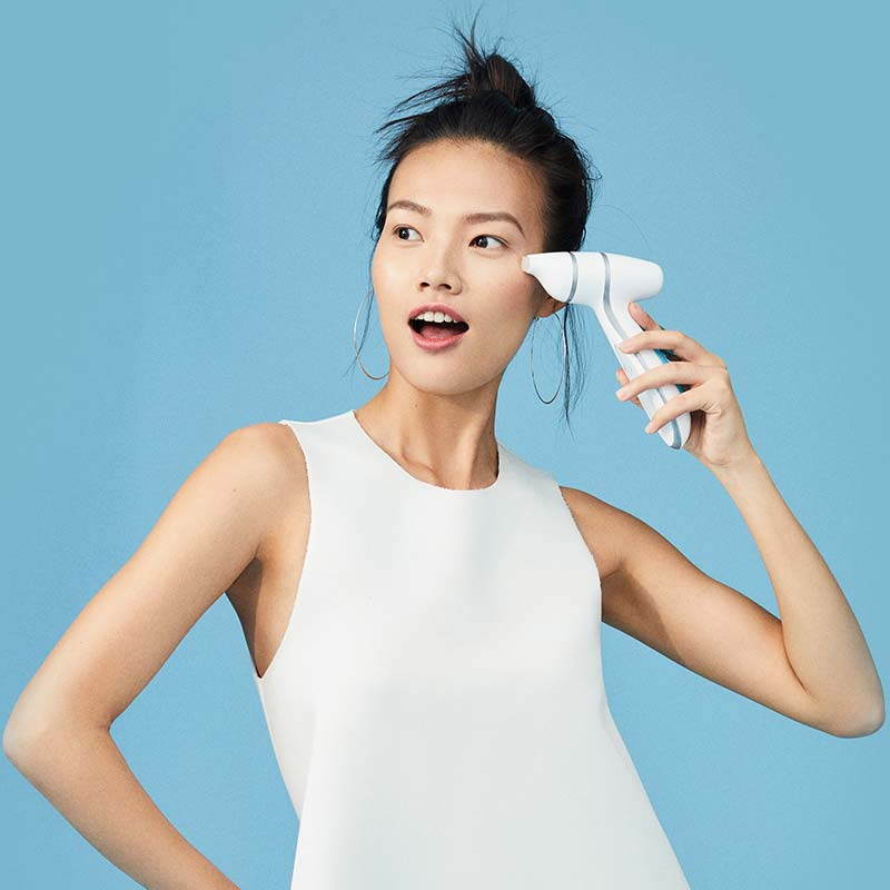Youthful woman posing with ageLOC LumiSpa Accent