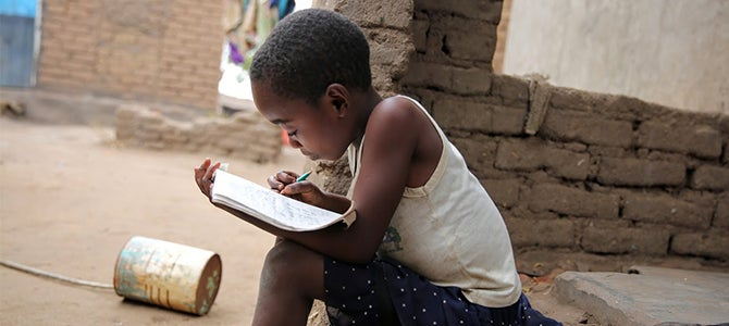A Malawi Child learning from Nu Skin's Educational initiatives