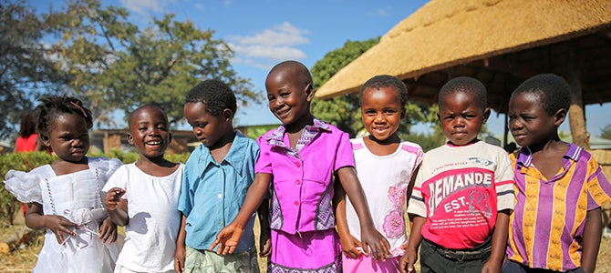 A group of Malawi children pose for a picture as they attend the School for Agriculture For Family Independence graduation.