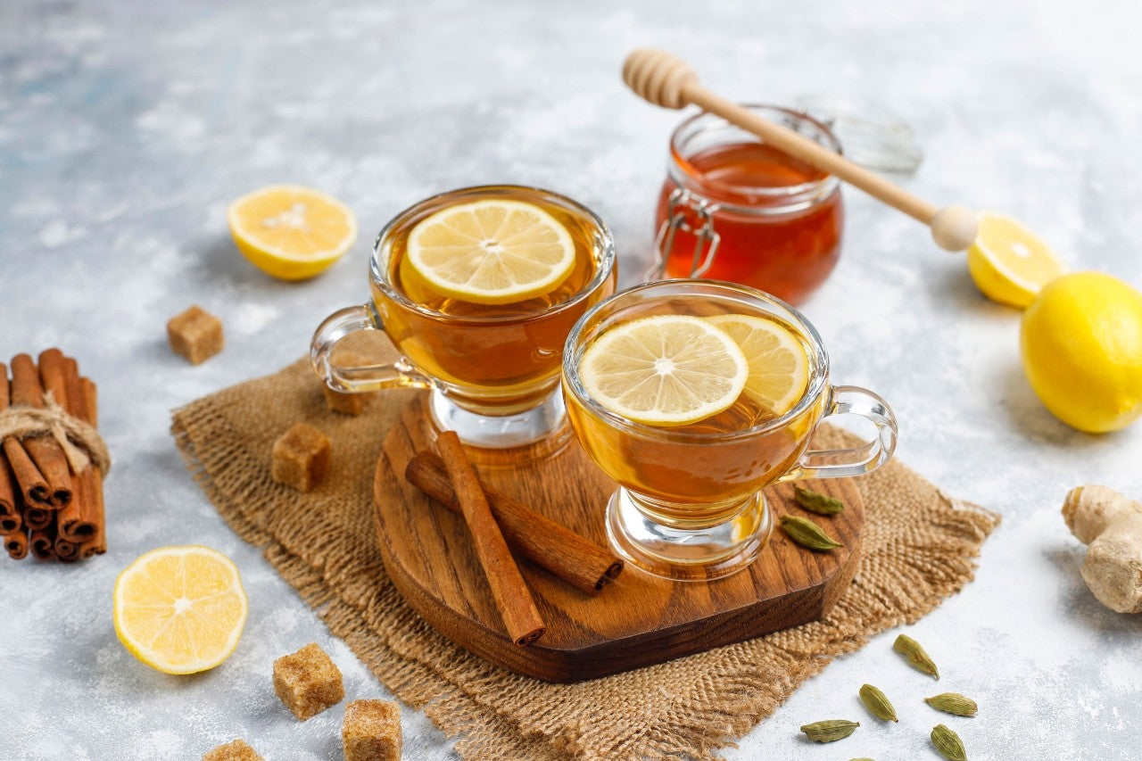 A cup of tea,brown sugar,honey and lemon on concrete  background. Top view, copy space